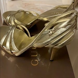 Gently worn sandals by Gucci